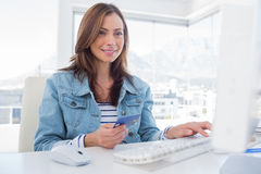 Cheerful woman purchasing online with her credit card Royalty Free Stock Photos