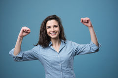 Cheerful woman with raised fists Stock Images