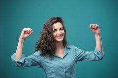 Cheerful woman with raised fists Royalty Free Stock Image