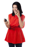 Cheerful woman read a message on the phone Royalty Free Stock Image