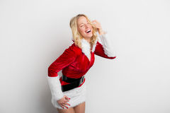 Cheerful woman in red Santa Claus costume Stock Image