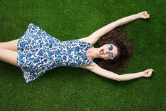 Cheerful woman relaxing on the grass Stock Photos