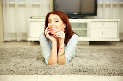 Cheerful woman resting on the floor Royalty Free Stock Photos
