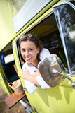 Cheerful woman in retro camping car Stock Images