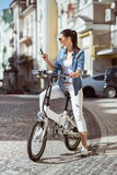 Cheerful woman riding a bicycle Royalty Free Stock Photos