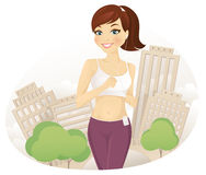 Running woman. Cheerful woman running in city park Royalty Free Stock Photo