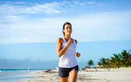 Cheerful woman running at tropical beach Royalty Free Stock Photography