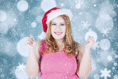 Cheerful woman in santa hat smiling at camera Stock Photography