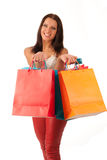 Cheerful woman with shopping bags Stock Photo