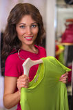 Cheerful woman shopping in clothes store Stock Photos