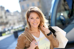 Cheerful woman on a shopping day in the city. Cheerful woman with shopping bags in town Royalty Free Stock Photo
