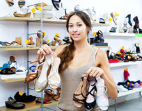 Cheerful woman shopping many shoes pairs Stock Photography