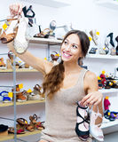 Cheerful woman shopping many shoes pairs Stock Photo