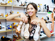 Cheerful woman shopping many shoes pairs Royalty Free Stock Photography