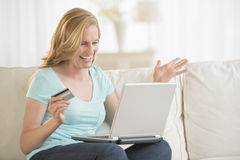Cheerful Woman Shopping Online At Home Stock Photo