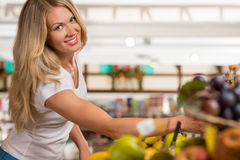 Cheerful woman shopping at organic food store Stock Image