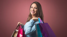 Cheerful woman shopping stock images