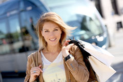 Cheerful woman shopping in town Royalty Free Stock Photos