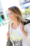 Cheerful woman shopping in town Royalty Free Stock Image