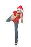 Cheerful woman shouting through megaphone shaped Stock Image