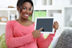 Cheerful woman showing digital tablet Stock Images