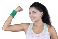 Cheerful woman showing her bicep Royalty Free Stock Photography