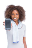 Cheerful woman showing her smartphone Stock Photos