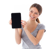 Cheerful woman showing tablet pc Royalty Free Stock Images