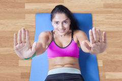 Cheerful woman sit-ups on the mattress Stock Photos