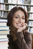Cheerful Woman Sitting With Books Stock Photos