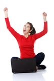 Cheerful woman sitting cross-legged with laptop Royalty Free Stock Photography