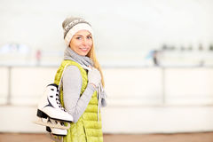 Cheerful woman on a skating rink Stock Image
