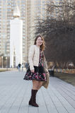 The cheerful woman smiles in the park in Tyumen. Royalty Free Stock Photography
