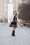 The cheerful woman smiles in the park in Tyumen. Royalty Free Stock Photos