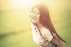 Cheerful woman smiling at camera in nature Stock Images