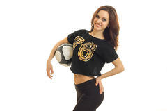 Cheerful woman smiling on camera with soccer ball in her hands Royalty Free Stock Images