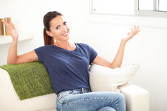 Cheerful woman smiling with her hands raised Royalty Free Stock Images