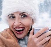 Cheerful woman snow portrait Stock Photo