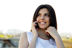 Cheerful woman speaking on the phon Stock Photography
