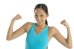Cheerful Woman In Sports Clothing Flexing Her Arms Royalty Free Stock Images