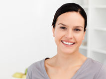 Cheerful woman standing in the kitchen Stock Photos