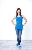 Cheerful woman standing at studio Royalty Free Stock Image