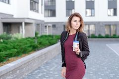 Cheerful woman in the street drinking morning coffee royalty free stock images