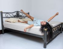 Young woman stretching in the bed Royalty Free Stock Image