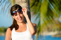 Cheerful woman on summer vacation wearing sunglasses Stock Photography