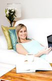 Cheerful woman surfing the internet Stock Photo