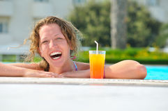 Cheerful woman in swimming pool Royalty Free Stock Photography