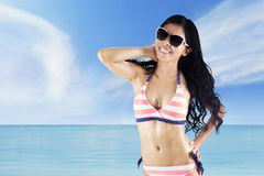 Cheerful woman with swimsuit at coast Stock Images