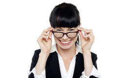 Cheerful woman taking off her spectacles Royalty Free Stock Photos