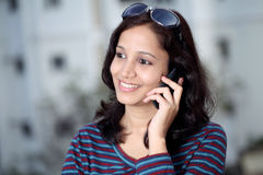 Cheerful woman talking on cellphone Royalty Free Stock Photo